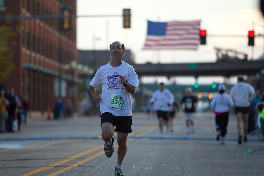 The runners begin arriving at the finish line after the shorter races within 15 minutes of the start of the Quad Cities Marathon 2010.