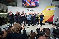 24 SEP 2017, BERLIN/GERMANY:<br /> Angela Merkel (M), CDU, Bundeskanzlerin, tritt ein zweites mal ans Mikrofon, eingerahmt von Karl-Josef Laumann, Philipp Murmann, Armin Laschet, Joachim Herrmann, Volker Kauder, Klaus Schueler, Thomas de Maiziere, David McAllister, Peter Tauber, Jens Spahn, Thomas Strobl, Elmar Brok, Monika Gruetters, Annegret Kramp-Karrenbauer, (v.L.n.R.), Wahlparty in der Wahlnacht, Bundestagswahl 2017, Konrad-Adenauer-Haus, CDU Bundesgeschaeftsstelle<br /> IMAGE: 20170924-01-068<br /> KEYWORDS: Election Party, Election Night