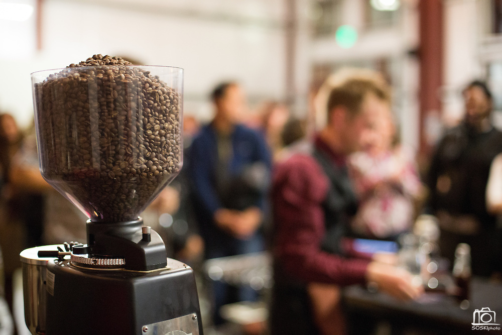 Justin Williams, 25, of Front Café in San Francisco uses a grinder full of Fine Chromatic Coffee beans to make four cups of coffee for the judges during the 2nd Annual Mock Barista Competition and Brewer's Cup at San Pedro Square Market in San Jose, California, on February 21, 2013.  (Stan Olszewski/SOSKIphoto)