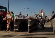 Evening rush-hour commuters walk homewards through the anti-terrorism security barriers on London Bridge, on 19th April 2018, in London, England.