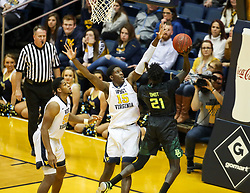 Jan 9, 2018; Morgantown, WV, USA; West Virginia Mountaineers forward Lamont West (15) defends Baylor Bears forward Nuni Omot (21) during the second half at WVU Coliseum. Mandatory Credit: Ben Queen-USA TODAY Sports