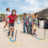 Children launch paper rockets they made Saturday at the Northfest held at the Larry Brian Mitchell Recreation Center in Gallup.
