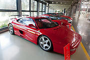 The Ferari 355 Challenge (1995) and others old Ferrari models sit on display at the New Mechanical Machining Area of the company auto plant in Maranello, Italy, on Monday, July 18, 2011. Photographer: Victor Sokolowicz/Bloomberg