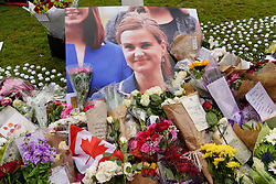 © Licensed to London News Pictures. 17/06/2016. Flowers and tributes in Parliament Square in memory of Labour party MP JO COX. She was allegedly attacked and killed by suspect 52 year old Tommy Mair close to Birstall Library near Leeds. London, UK. Photo credit: Ray Tang/LNP