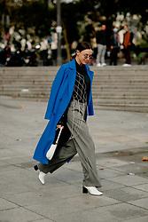 Street style, arriving at Ludovic de Saint Sernin Spring Summer 2022 show, held at Institut du Monde Arabe, Paris, France, on Ocotber 3rd, 2021. Photo by Marie-Paola Bertrand-Hillion/ABACAPRESS.COM