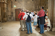 group of tourists listening to there guide in the St Lazare church France in Avallon