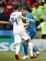 (l-r) Vladimir Granat of Russia, goalkeeper Igor Akinfeev of Russia during the 2018 FIFA World Cup Russia round of 16 match between Spain and Russia at the Luzhniki Stadium on July 01, 2018 in Moscow, Russia