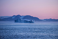 Large iceberg in dawn twilight off east coast of Greenland