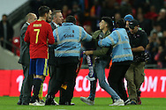 stewards remove a Pitch invader who attempted to get to Alvaro Morata of Spain after full time. England v Spain, Football international friendly at Wembley Stadium in London on Tuesday 15th November 2016.<br /> pic by John Patrick Fletcher, Andrew Orchard sports photography.