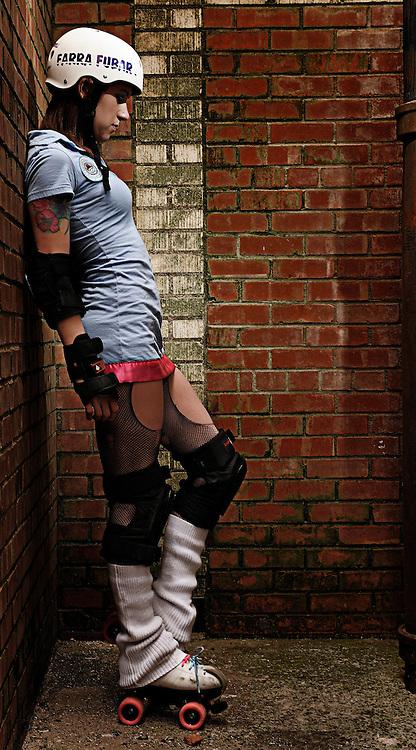 "Audra Laughlin aka ""Farra Fubar"" of the Red Dirt Rebellion Roller Girls banked track roller derby team"