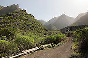 Water Resorvoires system ear Buenavista del Norte. On the background the mountains of Teno Alto