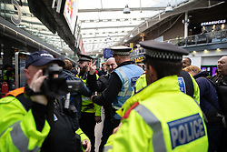 © Licensed to London News Pictures . 20/10/2018 . Manchester , UK . Hundreds of police contain approximately 50 EDL supporters in Piccadilly Railway Station . Street protest movement , the English Defence League ( EDL ) , hold a demonstration , opposed by anti-fascists , including Unite Against Fascism ( UAF ) , in Manchester City Centre . Amongst the reasons for their protest , the EDL cite news reports that revealed an imam at the Didsbury Mosque where Manchester Arena bomber Salman Abedi prayed , praised armed jihad in a sermon delivered just days before Abedi bought a ticket for the Ariana Grande concert at which he killed twenty two people . Photo credit : Joel Goodman/LNP