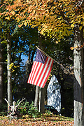 Stars and Stripes flag and Halloween skeleton at Wolfeboro in New Hampshire, New England, USA
