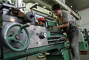 A factory worker makes machine parts in Shenyang. China is becoming the sweat shop of the world as large numbers of agricultural and former state enterprise workers chase work in the cities, depressing wages.