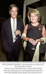 LT.COL.SIR CHRISTOPHER THOMPSON and the DOWAGER VISCOUNTESS PORTMAN, at a reception in London on 9th May 2001.ONU 83