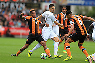 Federico Fernandez of Swansea city © is stopped by Abel Hernandez (l) and Curtis Davies ® of Hull city. Premier league match, Swansea city v Hull city at the Liberty Stadium in Swansea, South Wales on Saturday 20th August 2016.<br /> pic by Andrew Orchard, Andrew Orchard sports photography.