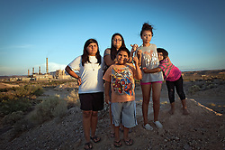 Left to right, the siblings of the Hernandez family stand in front of the Reid Gardner coal plant: Zayda Hernandez, 14,   Ayona Hernandez, 13,Gyiel, 7, Aaliya, 16, and Ayasha, 4 and on the Moapa reservation in Nevada. All of their family suffers from Asthma and though they can't prove it, believe its because of the coal plant next door. Her grandfather died in march because of cancer. The Sierra Club is working with the Moapa Band of Paiutes to transition NV Energy away from the Reid Gardner coal-fired power plant -- which sits only 45 miles from Las Vegas and a short walk from community housing at the Moapa River Indian Reservation. The Reid Gardner coal plant is literally spewing out tons of airborne pollutants such as mercury, nitrous oxide, sulfur dioxide, and greenhouse gases. This has resulted in substantial health impacts on the Moapa community, with a majority of tribal members reporting a sinus or respiratory ailment. Vernon Lee believes that the many people on the Moapa reservation suffering from health issues are because of the coal plant next door. Sierra Club is working with the Moapa Band of Paiutes to transition NV Energy away from the Reid Gardner coal-fired power plant -- which sits only 45 miles from Las Vegas and a short walk from community housing at the Moapa River Indian Reservation. The Reid Gardner coal plant is literally spewing out tons of airborne pollutants such as mercury, nitrous oxide, sulfur dioxide, and greenhouse gases. This has resulted in substantial health impacts on the Moapa community, with a majority of tribal members reporting a sinus or respiratory ailment.