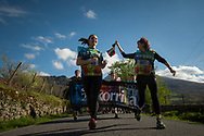 """Two women carry the baton as they run on the 20th Korrika. Erratzu (Basque Country) April 3, 2017. The """"Korrika"""" is a relay course, with a wooden baton that passes from hand to hand without interruption, organised every two years in a bid to promote the basque language. The Korrika runs over 11 days and 10 nights, crossing many Basque villages and cities, totalling some 2300 kilometres. Some people consider it an honour to carry the baton with the symbol of the Basques, """"buying"""" kilometres to support Basque language teaching. (Gari Garaialde / Bostok Photo)"""