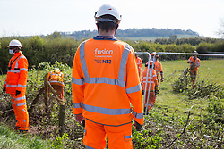 Tree surgeons contracted to HS2 clear a section of hedgerow to enable the construction of a temporary access road for the HS2 high-speed rail link on 26th April 2021 in Quainton, United Kingdom. Environmental activists continue to oppose the controversial HS2 high-speed rail link from a series of protection camps along its Phase 1 route between London and Birmingham.