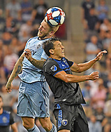 Sporting Kansas City forward Johnny Russell (7) heads the ball during the second half against San Jose Earthquakes midfielder Shea Salinas (6) at Children's Mercy Park.