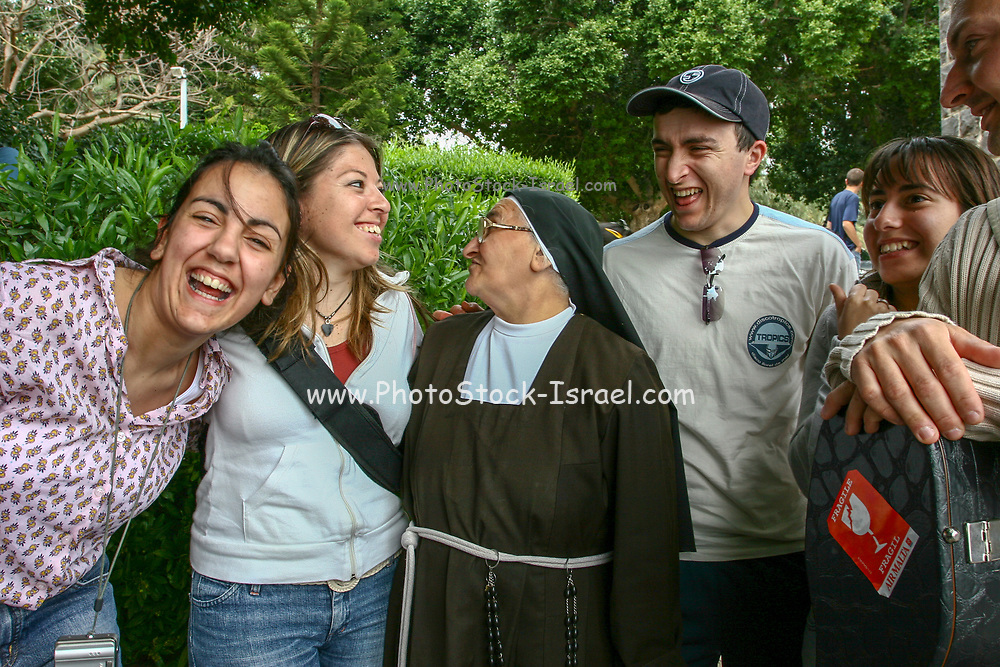 Nun and a group pilgrims at the Church of the Primacy of St Peter, Tabgha, Sea of Galilee, Israel