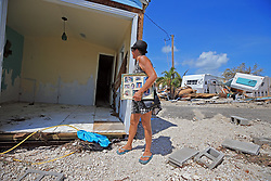 Laura Costello holds her family photos, the only item she salvaged from her trailer at Seabreeze trailer park in Islamorada along the Overseas Highway in the Florida Keys on Tuesday, September 12, 2017. Photo by Al Diaz/Miami Herald/TNS/ABACAPRESS.COM
