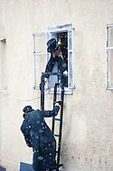 Imst Schemenlaufen, a traditional carnival held only once every four years in Imst, Tirol, Austria (31 January 2016). The Schemenlaufen is inscribed on the UNESCO list of Intangible Cultural Heritage. One of the carnival groups, dressed as chimney sweeps, use ladders to climb into windows from the street. © Rudolf Abraham