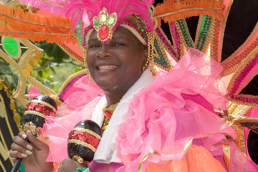 Traditional West Indian Caribbean dancer preforming during Carnival Day Parade on St. John, U.S. Virgin Islands