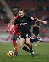 Jabo Ibehre and Luke Chambers.<br /> Leyton Orient v Northampton Town, Coca Cola League 2, London. 14/01/06 Photo by Barry Bland