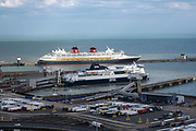 A Disney cruise ship moored up the Eastern Dock of the Port of Dover is where the cross channel port is situated with ferries departing here to go to Calais in France, on 26th August 2020 in Dover, Kent, United Kingdom.  Dover is the nearest port to France with just 34 kilometres 21 miles between them. It is one of the busiest ports in the world. As well as freight container ships it is also the main port for P&O and DFDS Seaways ferries.