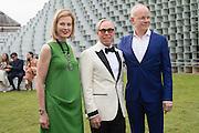 JULIA PEYTON-JONES; TOMMY HILFIGER; HANS ULRICH OBRIST;  2016 SERPENTINE SUMMER FUNDRAISER PARTY CO-HOSTED BY TOMMY HILFIGER. Serpentine Pavilion, Designed by Bjarke Ingels (BIG), Kensington Gardens. London. 6 July 2016