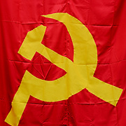 A hammer and sickle, the flag of international communism. The hammer is symbolic of the industrial proletariat, while the sickle is symbolic of the agricultural peasantry.