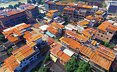 Amazing Aerial View of Fruit being dried on Roof tops