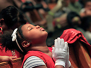 1/12/2014- The 3rd Annual Remembrance of Life Ceremony at Church of the Ascension in north Minneapolis. - Princess Ann Nelson, eight, who lost her brother Anthony Titus to gun violence whn he was sixteen, prayed during the ceremony along with others who had lost loved ones in the same way.