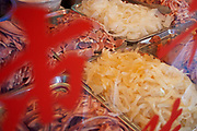 Chopped cooked meats and pickled vegetables served from a hatch painted in Chinese characters on Renmin Lu. This is a common sight on many streets.