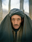 Sardar Khan, protecting himself from the cold..Family relatives of Pir Shah Ismail in Qala-e Pinja.