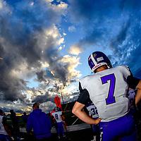 A sunset sky flourishes above Miyamura Patriot quarterback Matt Chavez (7) at Wilson Stadium in Albuquerque Thursday.