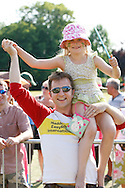 Photo by Andrew Tobin/Tobinators Ltd - 07710 761829 - New 2013 World Champion Rob Bresler with his daugher and 2013 Junior World Champion Madeline celebrate during the World Peashooting Championships held at Witcham, Cambridgeshire, UK on 13th July 2013. Run in conjunction with the village fair, the Championships have been held in Witcham since 1971 when they were started by a Mr Tyson, the village schoolmaster, in order to raise funds for the village hall.Competitors come from as far afield as the USA and New Zealand to attempt to win the event. The latest technology is often used, including laser sights and titanium and carbon fibre peashooters. All peashooters must conform to strict length rules, not exceeding 12 inches, and have to hit a target 12 feet away. Shooting 5 peas at a plasticine target attached to a hay bale, the highest scorers move through the initial rounds to a knockout competition, followed by a sudden death 10-pea shootout.