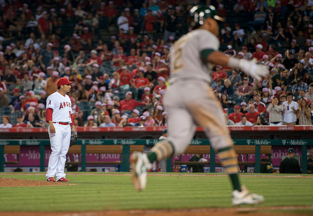 Angels' relief pitcher Fernando Salas stands near the mound as the Athletics' Khris Davis celebrates his three-run home run in the eighth inning at Angel Stadium on Friday.<br /> <br /> ///ADDITIONAL INFO:   <br /> <br /> angels.0625.kjs  ---  Photo by KEVIN SULLIVAN / Orange County Register  --  6/24/16<br /> <br /> The Los Angeles Angels take on the Oakland Athletics Friday at Angel Stadium.<br /> <br /> <br />  6/24/16