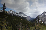 Patchy sun over mountains along the Icefields Parkway, in Jasper National Park, Alberta, in the Canadian Rockies