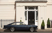 A classic Aston Martin DB5 is parked outside number 46, Chester Square SW1 in London's Belgravia. Such an example of great British design sits well outside this fine house on the western end of this Square laid out in 1840 by Thomas Cubitt and attracting the personalities of the day such as Mary Shelley, Violinist Yehudi Menuhin and Prime Ministers Harold Macmillan and Margaret Thatcher. Along with its sister squares Belgrave Square and Eaton Square, Chester Square is one of the most desirable addresses in London. The 1963 Aston Martin DB5 has a top speed of 141 mph (227 km/h) and was made famous by Sean Connery as James Bond in Goldfinger.