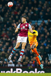 Rudy Gestede of Aston Villa and Aaron Pierre of Wycombe Wanderers compete in the air - Mandatory byline: Rogan Thomson/JMP - 19/01/2016 - FOOTBALL - Villa Park Stadium - Birmingham, England - Aston Villa v Wycombe Wanderers - FA Cup Third Round Replay.