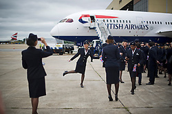 © London News Pictures. 04/07/2013 . London, UK.  British Airways staff pose for photographs in front of a Boeing 787 as they wait for a new British Airways Boeing A380 superjumbo to arrive at Heathrow Airport. It was the first time British Airlines have taken delivery of the new plane, making British Airways the first European airline to operate both the 787 and A380. Photo credit : Ben Cawthra/LNP