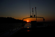 Sunset over island of Korcula, Peljeski Kanal, Croatia.