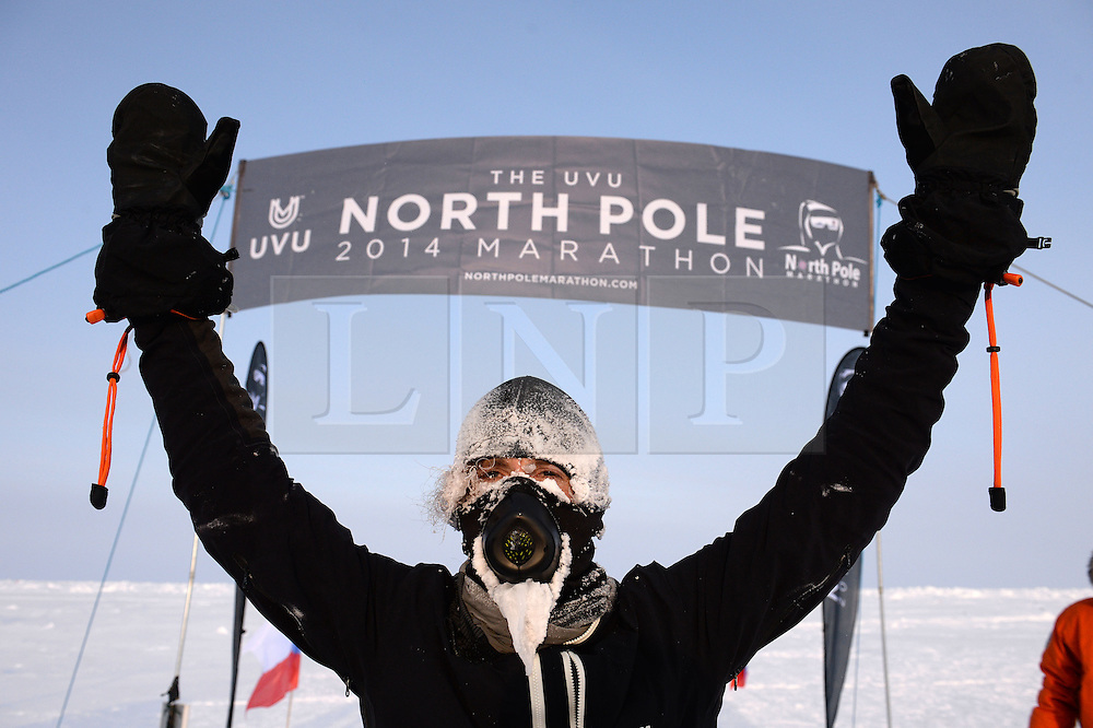 © Licensed to London News Pictures. 10/04/2014. The men's race was won by Michael Wardian of USA (pictured) with a time of 4:07:40 hrs. The UVU North Poe marathon 2014 which took place at a temperature of minus 30 degrees. Run over the classic 42.195km (26.2 miles ) marathon distance it is described as the world coldest marathon. Held at the top of the world it is also the worlds most remote marathon race. The men's race was won by Michael Wardian of USA (pictured) with a time of 4:07:40 hrs. Photo credit : Mike King/LNP