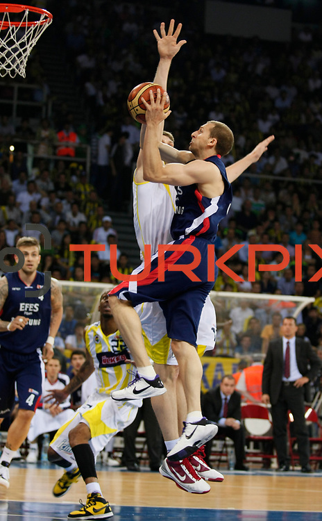 Efes Pilsen's Sinan GULER (F) during their Turkish Basketball league Play Off Final fourth leg match Fenerbahce Ulker between Efes Pilsen at the Abdi Ipekci Arena in Istanbul Turkey on Thursday 27 May 2010. Photo by Aykut AKICI/TURKPIX