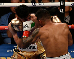 6-9-18. Los Angeles, CA. (in gold trunks ) Leo Santa Cruze goes 12 rounds with Abner Mares at Staples Center Saturday. Leo Santa Cruze  took the win by  unanimous decision over Abner Mares for the WBA featherweight title and WBC diamond tile on showtime. Photo by Gene Blevins/LA DailyNews/SCNG/ZumaPress (Credit Image: © Gene Blevins via ZUMA Wire)