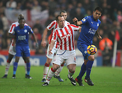 Charlie Adam of Stoke City and Leonardo Ulloa of Leicester City (R) in action - Mandatory by-line: Jack Phillips/JMP - 17/12/2016 - FOOTBALL - Bet365 Stadium - Stoke-on-Trent, England - Stoke City v Leicester City - Premier League