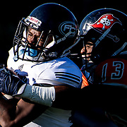 Fullerton College wide receiver, DeAndre McNeal, gets tackled by Orange Coast College's running back, Aundre Carter, during a football game in  Lebard Stadium at Orange Coast College on November, 5, 2016. Fullerton College won the game 34-14. <br /> <br /> Carolyn Rogers/ SSA