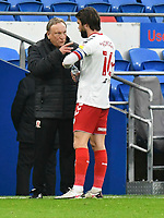 Football - 2020 / 2021 Sky Bet Championship - Cardiff City vs Middlesbrough - Cardiff City Stadium<br /> <br /> Middlesborough manager Neil Warnock on his return to Cardiff City speaks to Jonny Howson of Middlesbrough on the touchline<br /> in a match played without fans<br /> <br /> COLORSPORT